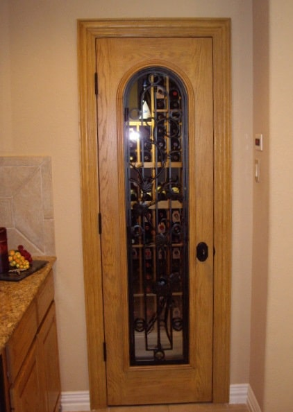 Elegant Door Designed for a Residential Custom Wine Cellar Built in a Small Closet