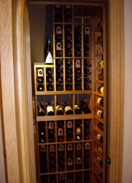 Custom Wine Racks Designed for a Residential Wine Cellar Built in a Closet