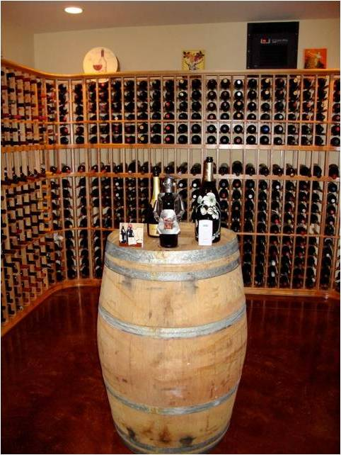 Custom Home Wine Cellar with an Efficient Cooling Unit Installed by Las Vegas Master Builders