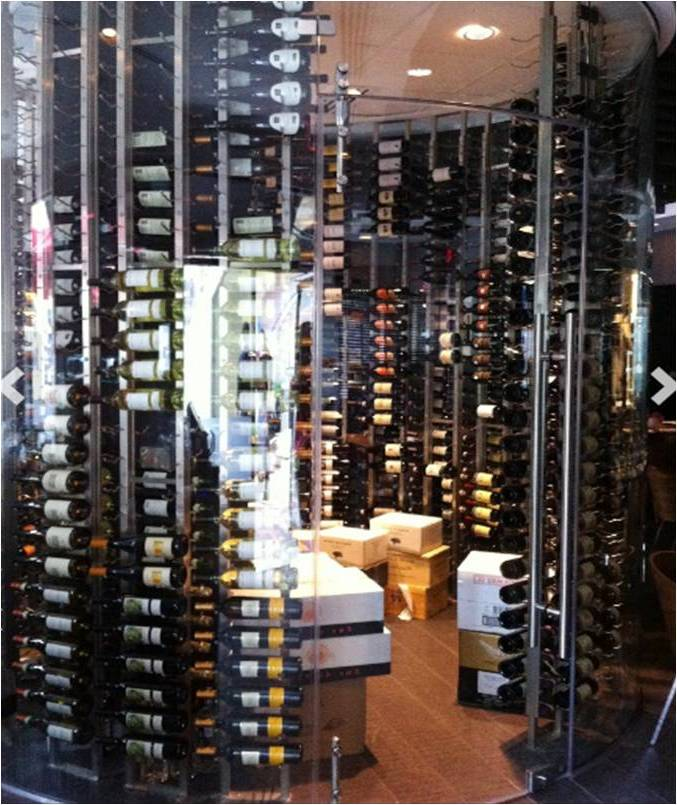 Glass-Enclosed Glass Commercial Wine Cellar with VintageView Custom Wine Racks Built by Trusted Las Vegas Installers